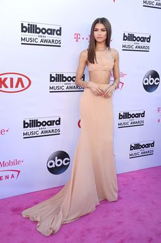 Because she transcends all the regular fashion norms, Zendaya made a show-stopping entrance in a Calvin Klein Collection peach bralette with mesh detailing and matching maxi skirt with a train for days.