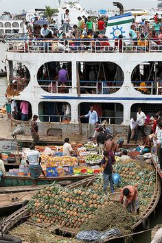 -Loading a launch in Sadarghat harbour, Bangladesh..