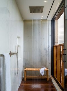 Like the teak (?) floors with no drain showing.  Shower head and marble walls are fantastic too!