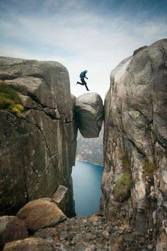 Kjeragbolten is a Norwegian boulder located in Kjerag mountain in Rogaland, Norway. The rock itself is a 5 m³ glacial deposit wedged in the mountain's crevasse suspended above 984-meter a deep abyss. #courage