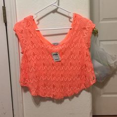 NWT Crop Top A beautiful coral crop top by Charlotte Russe with no flaws. Original tags still attached. Please ask for more pictures or info. Charlotte Russe Tops Crop Tops