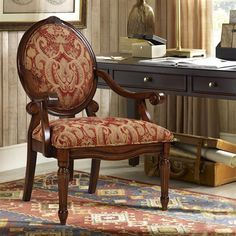 Discover sophistication in a traditional, yet classic design with this oval back wood chair. The wonderful mix of burgundy's and warm goldish-browns adds definite traditional appeal. Some assembly required.