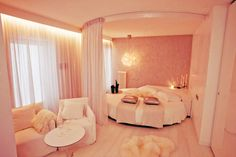 Pink, white, and round bed.