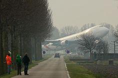 Boeing 747 landing from strange angle.