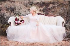 Bride on a vintage couch for sunset bridal portraits in Snow Canyon National Park.