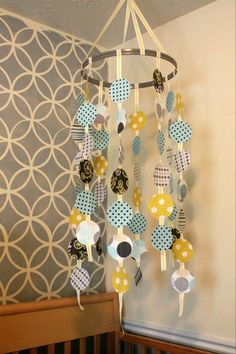 Another really cool mobile using some ribbon, cardstock/stationary and a sewing hoop :)