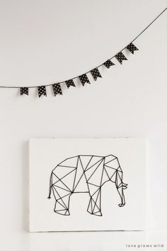 Liz from Love Grows Wild turned the geometric trend into this Geometric Elephant Art. She has the full tutorial on her blog.