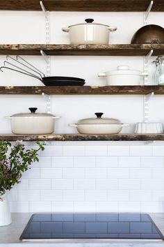 Just ran across some amazing shots of the @Food52 test kitchen on Remodelista. Clean white with open reclaimed wood shelving. Jealous.