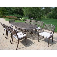 Oakland Living 2105-2012-17-AB Mississippi Oval NinePiece Outdoor by Oakland Living. $2578.00. Mississippi Oval Nine-Piece Dining Set with Cushions Thisdining set is the prefect piece for any outdoor dinner setting. It is just the right size for any backyard or patio.  Set includes:  One ovaldiningtable - 84'L x 42'W x 29'H  Eight dining chairs with seatcushions - 21.5'W x 23'BackToFront x 34'H Features:  Rust free cast aluminum construction  Hardened powder coat finish ...