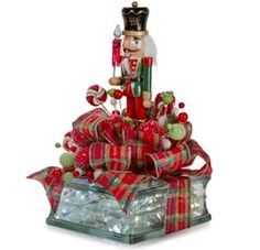 Give your favorite nutcracker a new look with a glass block, some shiny metallics and lots of ribbon! Find the perfect supplies at Pat Catan's. block craft ideas Welcome to Consumer Crafts! Nutcracker Crafts, Nutcracker Christmas, Christmas Tea, Decorative Glass Blocks, Lighted Glass Blocks, Painted Glass Blocks, Glass Cube, Glass Boxes, Christmas Projects