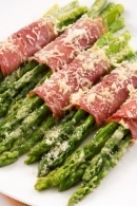 Asparagus wrapped in prosciutto, sprinkled with Parm.  I like to spread Cream Cheese on the prosciutto then roll around Asparagus and bake in the oven.