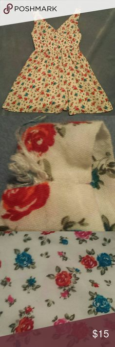 Floral Tank Preloved! Can be worn as a tank top or mini dress! Has roses in blue, red and pink all over! Only considerable flaw is a tiny bit of fraying on the left shoulder strap (see photo #2) Love Tree Tops Tank Tops