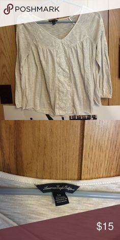 White half sleeve American Eagle top Hardly worn and it super cute! American Eagle by Payless Tops