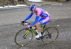Damiano Cunego climbs to Pordoi Pass, under the snow, in the 4th stage of Giro del Trentino [2012]    ©BettiniPhoto