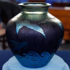 Steuben acid cut back vase, and it's blue aurene over dark blue. It is a piece done by Frederick Carder