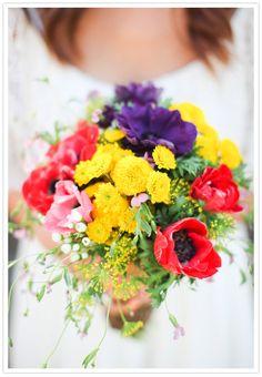 A bright, bold wildflower #wedding bouquet!  From http://100layercake.com/blog/2012/12/06/diy-southern-california-wedding-christian-reinna/  Photo Credit: http://maxwangerblog.com/