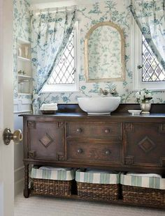 "beautiful use of an antique sideboard as a vanity.  love the curtains and the windows.  I wonder if you could frame some ""fake"" windows in a bathroom without?"