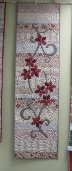 Flourish Table Runner. Made with French General fabrics. Model is hand appliqued. Pattern and kits available. Calico House Lincoln, Ne 402 489 1067.  SOLD OUT