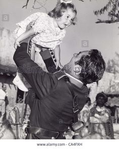TYRONE POWER with daughter.Supplied by   Photos inc.