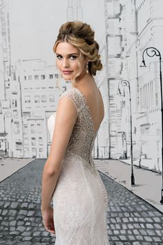 Justin Alexander - Style 8882: V-Neck Fit and Flare Lace Gown with Beaded Illusion Back and Straps
