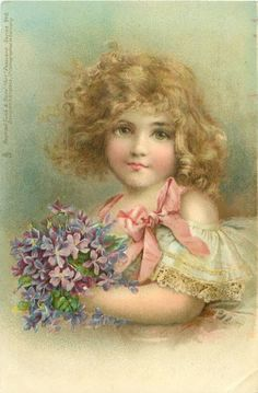 girl in white lace dress & pink bow holds violets in front of her
