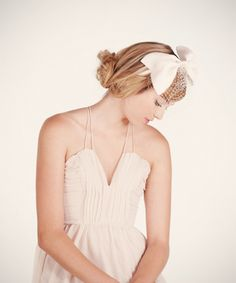 organza bow headband $225 this giant silk organza bow is hand tacked to an off white silk satin headband and adorned with a sweet birdcage veil.
