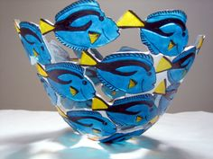 """""""Tang"""" art glass bowl created by Ann Alderson Biba. The glass bowl is first blown into its initial form, then carved to produce the figures, and hand painted for the final color. Sandblasted Glass, Slumped Glass, Melting Glass, Kiln Formed Glass, Fused Glass Art, Stained Glass, Ceramic Fish, Glass Animals, Fish Art"""