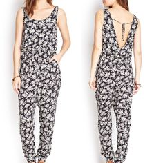 TODAY ONLY‼️ Floral Jumpsuit Super cute jumpsuit. On trend for spring/summer '16! Black with cream floral design. Pants Jumpsuits & Rompers