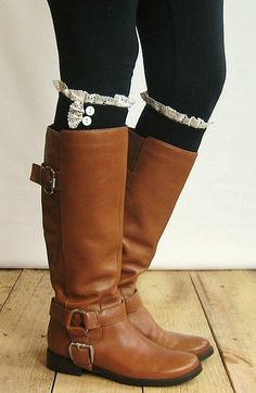 Dress up your boots with the lace trim boot socks with button accent. One size fits most.