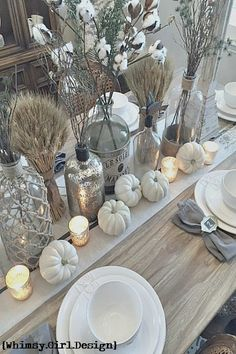 A collection of glass bottles, mainly found at Homegoods, stays on our dining table all year long. Just add in seasonal stems and you have a brand new look for each holiday! {Sponsored Pin}