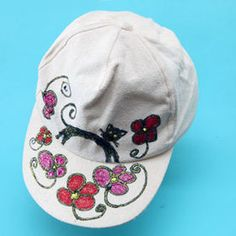 White cap for sun protection - great, but boring. Add a colorful image to it, just a little bit of glitter paint and you'll never want to take it off! Glitter Paint, White Caps, Just A Little, Sun Protection, Baseball Hats, Textiles, Colorful, Painting, Image