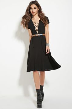A woven dress complete with short sleeves, a lace-up neckline, and an invisible back zipper.