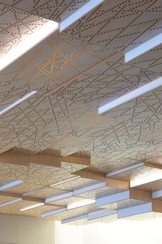 Perforated ceiling panels allow patterned light.  French Ministry of Agriculture, Press Conference Room, Paris, by h2o architects
