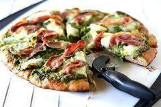Arugula Pesto Pizza on Whole Wheat Crust.  I had something similar at EVO once.  I think I'd add caramelized onions as well.