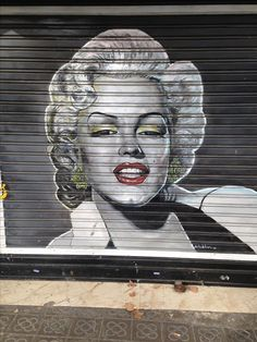 This street art is Marylin Monroe, who was a huge sex symbol. While we can not see her body here, the artist decided to make the picture fully black and white except for her red lips. accentuating them and making it more seductive. Even though she was a seemingly American icon, she has passed geographic boundaries and is known all over the European world.