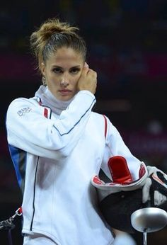 Photo from Facebook. Epee fencing is part of the Modern Pentathlon. Élodie is an…