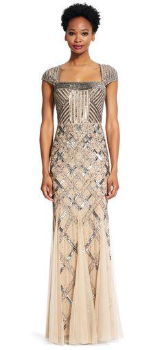 02ab72ca70cf Brilliant beaded ribbon designs splash elegantly across this evening gown.  Featuring a cap sleeve design