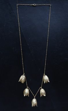 Gold Tulip Necklace - Made of gold-plated solid brass flower charms on a gold-plated chain. Each tulip has white mountain jade beads at center.