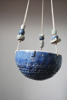Hanging planter with beads.