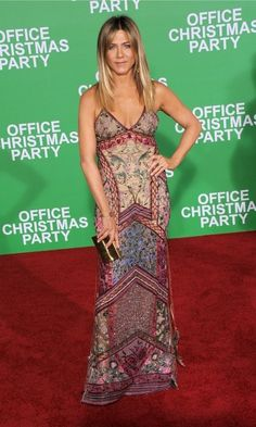 Jennifer Aniston wore a multi-colored gown by Roberto Cavalli during the premiere of Office Christmas Party in Westwood, California.