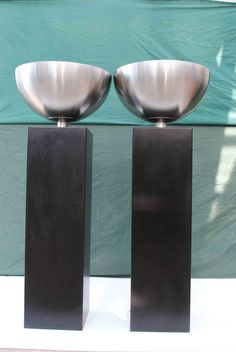 2 black aluminium plinths with attached stainless bowls Overall height 130cm Bowl diameter 50cm In excellent condition