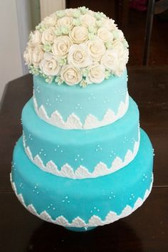 aqua with white roses wedding cake...I love | http://specialweddingcakeideas576.blogspot.com
