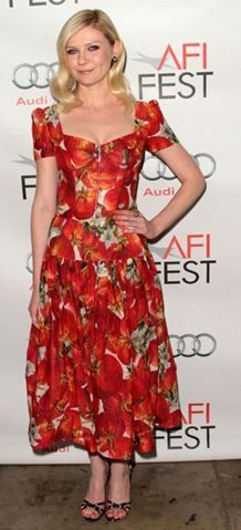 Who made Kirsten Dunst's red floral dress that she wore in Hollywood on November 6, 2011? Dress and shoes – Dolce & Gabbana  Jewelry – Van Cleef & Arpels