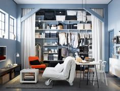 In rooms without closet space this is a great idea! Make the room about 1.5 feet smaller but add floor to ceiling storage space! Great idea with the woodworking and curtains to maintain a clean look...