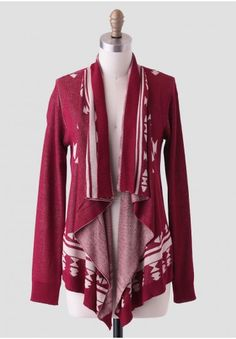 <p>Keep warm in style with this burgundy-colored cardigan featuring an open-front and an asymmetrical-draped front. Adorned with an Aztec-inspired design in a beige hue and finished with ribbed hems, this charming cardigan can be layered over a basic tee and skinny jeans for a rustic-chic ensemble.</p><p>100% Viscose<br /> Imported<br /> 25