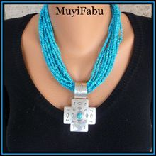 Multi-Strand Turquoise Necklace With Sterling Silver Cross Pendant $250  http://www.rubylane.com/shop/muyifabu