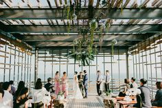 This wedding at Alila Villas Uluwatu features a totally dreamy ceremony space, surreal photography, and breathtaking tropical reception décor.