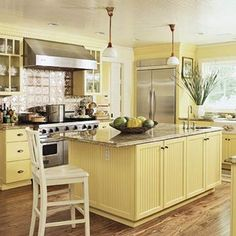 I love the beadboard, bin pulls, lots of light and lower cabinets. Being vertically challenged, my dream kitchen would have as few upper cabs as possible. I like the yellow but would add blue accents.