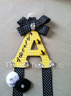 Taylors Treasures  - Hair Bow Holder - Bumble Bee Patterned Letter  - Personalized With Any Name. $8.99, via Etsy.