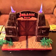 This Jurassic Park birthday cake is possibly the coolest cake I've ever seen. There are even two sterno lamps to create the flames like the front gate in the real movie. For comparison's sake, here's the actual front gate.